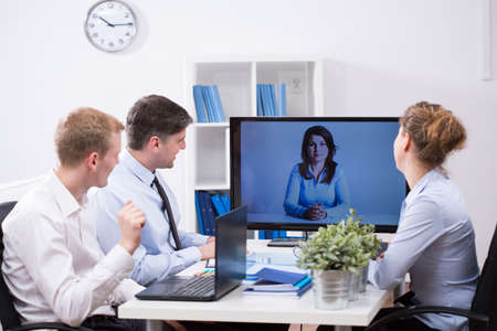 conference room meeting: Modern office - business team having web conference