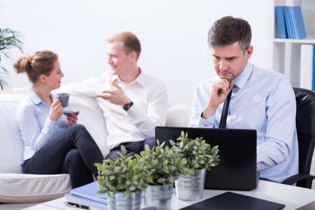 Image of employees working in modern small business Stock Photo