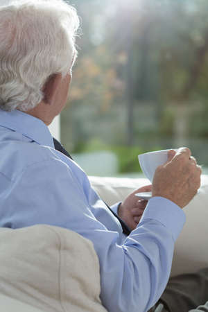 Senior man relaxing with a cup coffee Stock Photo