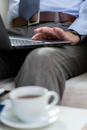 everyday jobs: Vertical view of elderly man using laptop