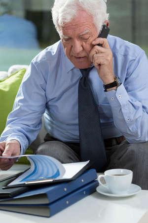 View of elder businessman talking on phone