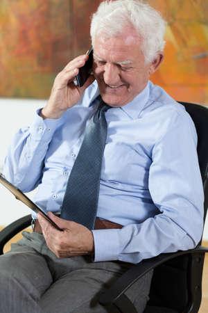 View of elder man talking on phone