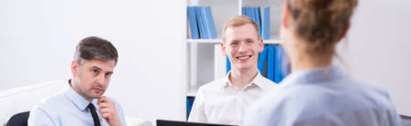 Panorama of female manager talking with employees Stock Photo