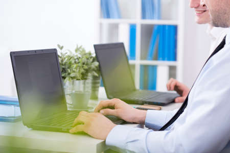 and white collar workers: White collar workers typing on the keyboard Stock Photo