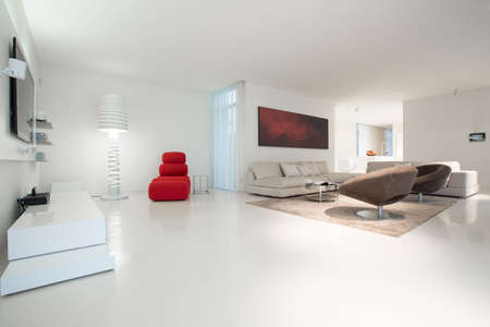 Enormous elegant lounge with white marble floor