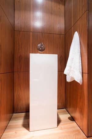 White fancy porcelain basin in wooden bathroom Stock Photo