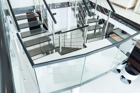 Glass stairs in the modern residence Stock Photo