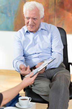 everyday jobs: Elder man having business meeting at home