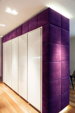 Big white and violet closet in exclusive apartment Stock Photo