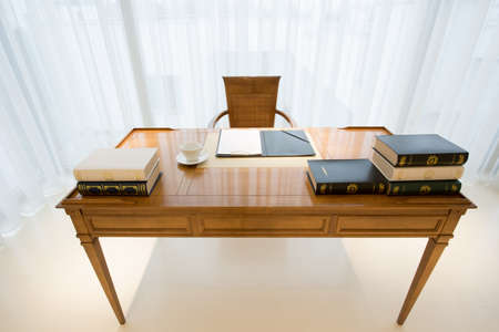 Wooden vintage style desk with elegant books