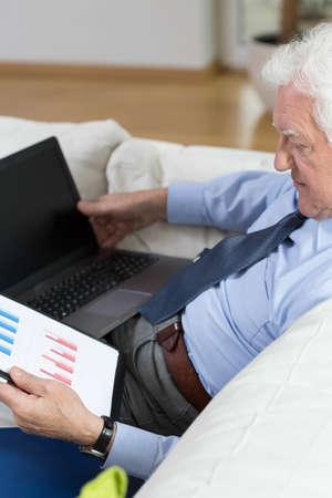 View of senior man analyzing a chart