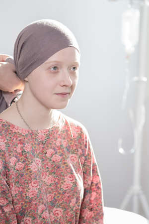 neoplasm: Portrait of cancer teenage girl wearing headscarf