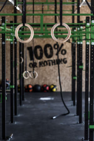 gym equipment: Photo of crossfit zone with gymnastic circles on gym