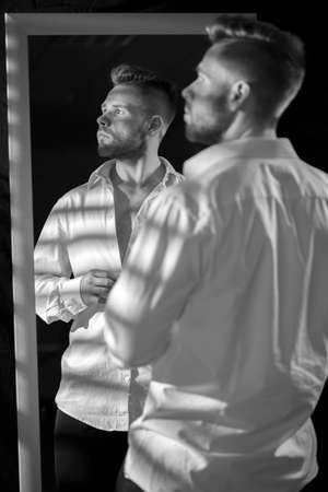 narcissistic: Black and white picture of attractive male model