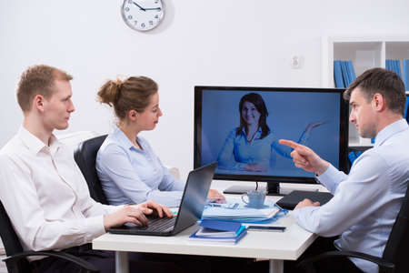 watch video: Modern business people meeting during video conference