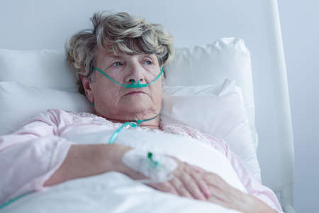 Female senior with nasal cannula staying in hospital