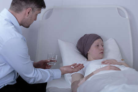 depressed person: Image of father giving medicines to his ill daughter