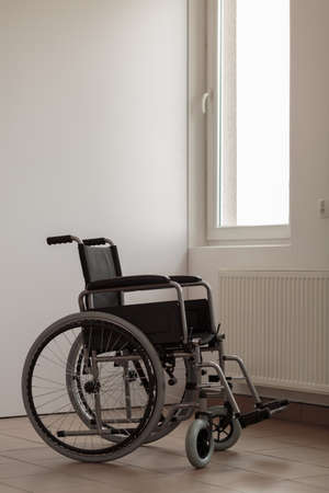 mobility nursing: Vertical view of wheelchair in empty room