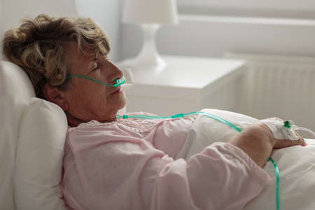 lung disease: Image of sick woman with nasal cannula Stock Photo