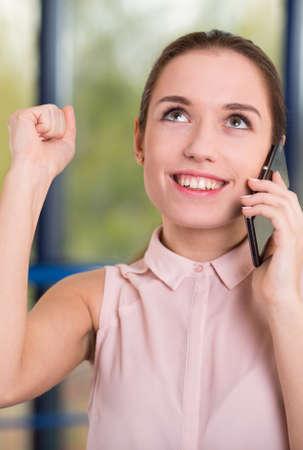 succesful: Pretty smart businesswoman and successful transaction