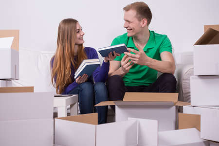 unpacking: Couple unpacking cardboard boxes in their new house Stock Photo