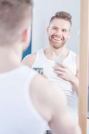 narcissistic: Narcissistic man taking a photo of himself