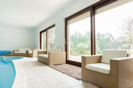 window treatments: Modern huge mansion with a swimming pool