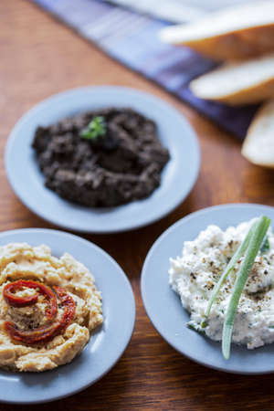 chickpea: Three tasty pastes of hummus, tapenade and cottage cheese Stock Photo