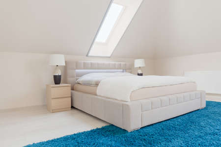 double bed: Big double bed in white bright bedroom