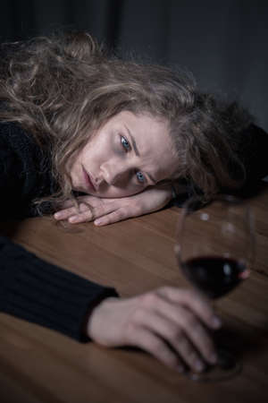 Picture presenting problem of alcoholism among young adults Фото со стока
