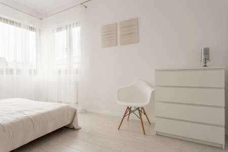 home interior: Simple exclusive white bedroom with wooden parquet