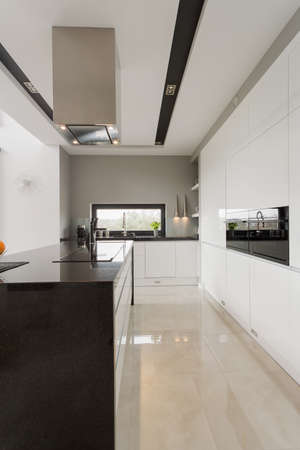 Shining marble floor in modern spacious kitchen photo