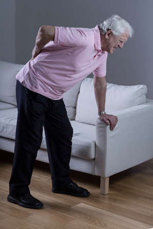 senior pain: Retired man with sciatica spasm