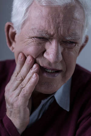 obsolescence: Old man with horrible toothache