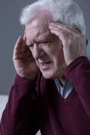 Elderly men having horrible migraine