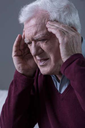 horrible: Elderly men having horrible migraine