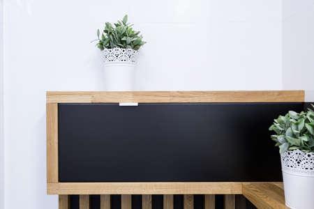 flowerpots: Plants in white flowerpots in modern apartment
