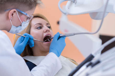 intervention: Young scared woman having dental intervention