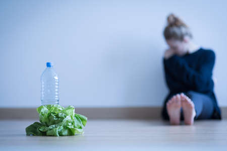 sick person: Girl with anorexia being on restricted diet Stock Photo
