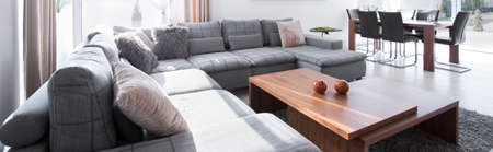 rest room: Big comfortable couch and stylish wooden coffee table