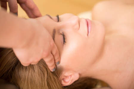 Close-up of woman having bioenergy therapy photo