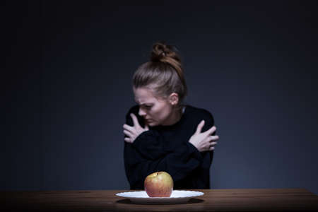 anorexia girl: Lonely despair girl suffering from anorexia nervosa
