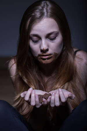 bulimia: Woman suffering from bulimia eating a lot of chocolate