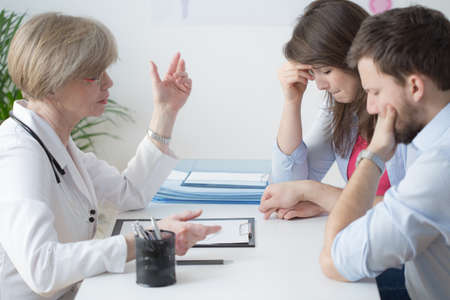 color consultation: Experienced gynecologist talking with infertile marriage about solution