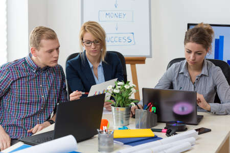 Young adults working at modern designed office