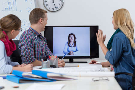 web conference: Young businesspeople at video conference at office Stock Photo