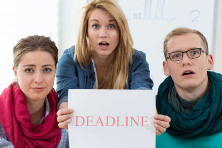 project deadline: Stressed office workers because of the project deadline