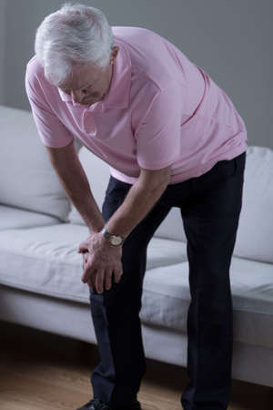 Elderly man with knee pain