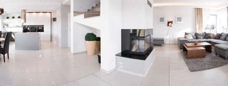 Panorama of kitchen and living room in exclusive residence