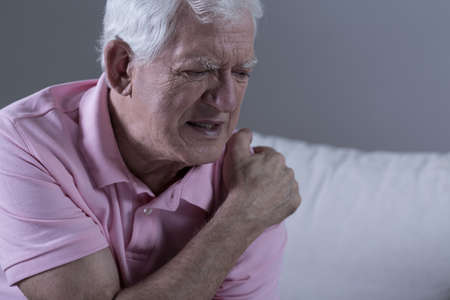 shoulder problem: Senior suffering from shoulder pain